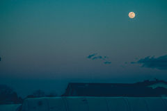 Full Moon over the Roofs Stock Photos