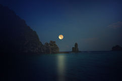 Full moon over the sea. Beautiful full moon night over the sea and mountain Stock Photo