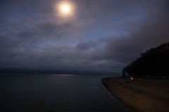 Full moon over the sea. Full moon with clouds and sky over the sea Stock Photo