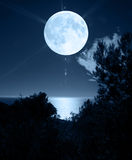 Full moon over sea Stock Photos
