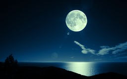 Full moon over sea Stock Images