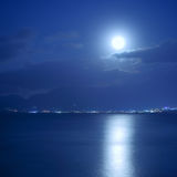 Full moon over sea. And moon-glade, Crete Island, Greece Royalty Free Stock Photos