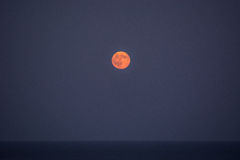 Full Moon over the sea III. Full moon on a clear night out on the horizon over the sea Stock Image