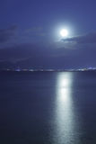 Full moon over sea. Full moon over Mediterranean Sea and moon-glade, Crete Island, Greece Stock Image