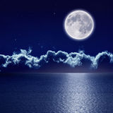Full moon over sea. Peaceful background, night sky with full moon and reflection in sea, stars, beautiful clouds. Elements of this image furnished by NASA Royalty Free Stock Photos