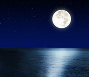 Full moon over the sea Stock Photography