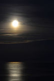 Full moon over the sea Stock Photos