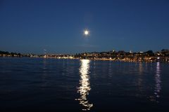Full Moon over Stockholm Harbor Royalty Free Stock Photography