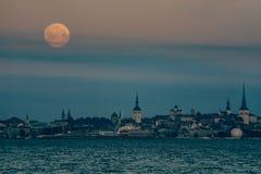 Full moon over Tallinn city, Estonia Stock Photos