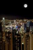 Full Moon Over Victoria Harbor at Night, Hong Kong Stock Image