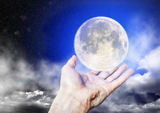 The full moon is on the Palm of your hand Royalty Free Stock Images