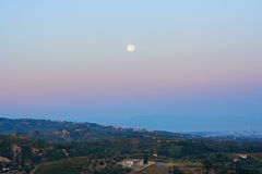 Full moon perigee during sunrise in sicily Stock Images