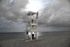 Lifeguard stand makes for a dramatic scene on the beach at midnight. The full moon provides a breathtaking look at the ocean waves as they gently lap the royalty free stock photography
