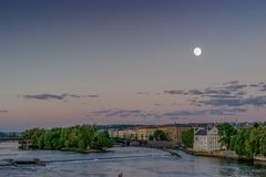 Full moon in the purple sky at Prague with Vltava river scene. Czech Republic Stock Image
