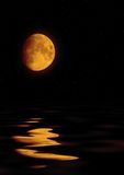Full moon reflected in water Stock Images