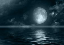 Full moon reflected in water. The full moon in the night sky reflected in water Royalty Free Stock Photos