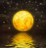 The full moon is reflected in  wavy water Stock Photography