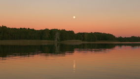 Full moon reflecting in a lake. Night schene. View from the water. Full HD stock video