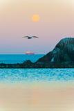 Full moon reflecting on pool on coast Royalty Free Stock Images
