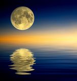 Full moon reflection. Full moon on reflectied water surface Stock Image