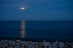 Full moon with reflection on sea Stock Photo