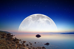 Full moon rise stock images
