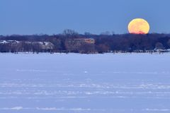Full moon rise over Lake Monona Stock Photo