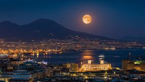Full Moon Rises Above Mount Vesuvius, Naples And Bay Of Naples, Italy Royalty Free Stock Photography