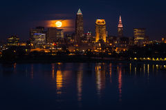 Full Moon Rises Over Cleveland Ohio. Supermoon rises above the Cleveland skyline royalty free stock photography