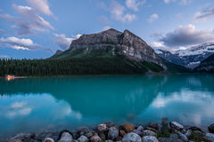 A full moon rises over the Lake Louise Boathouse Stock Photography