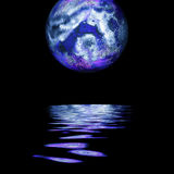 Full moon rising. Large moon reflecting over smooth waves on water  on black outer space nice web background Stock Photography
