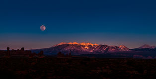 Full Moon Rising above La Sal Mountains Arches National Park Royalty Free Stock Photos