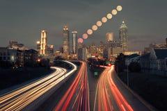 Full moon rising over Atlanta skyline Royalty Free Stock Photo