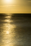 Full moon rising over the ocean with magical reflection Royalty Free Stock Images