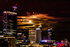 Full moon rising over the city Stock Photo