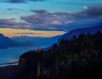 Full Moon Rising Over Crown Point on the Columbia River. The full moon is rising over Vista House in the twilight.     Crown Point is one of many beautiful Royalty Free Stock Photos