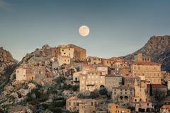 Full moon over Balagne village of Speloncato in Corsica Stock Image