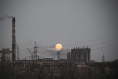 Full moon rising over industrial landscape. Panorama of full moon rising over industrial landscape royalty free stock image