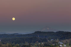 Full Moon Rising Over Mount Hood Stock Images