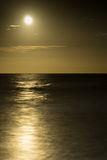 Full moon rising over the ocean Royalty Free Stock Photo