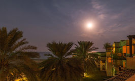Full moon rising. Full moon over the sea - Fujairah, UAE Stock Images