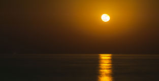 Full moon rising. Full moon over the sea - Fujairah, UAE Royalty Free Stock Photography