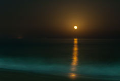 Full moon rising. Full moon over the sea - Fujairah, UAE Stock Photography