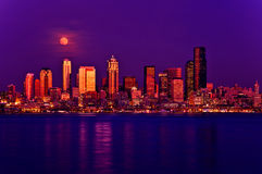 Full moon rising over Seattle Stock Images