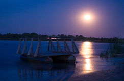 Full moon on river. Full moon reflecting on a river at night Royalty Free Stock Image