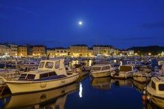 Full moon Rovinj at dusk, Croatia. Full moon over the port of Rovinj at dusk, Croatia Stock Photo