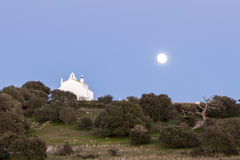 Full moon in a rural landscape of Castro, Verde, in the Alentejo. Portugal. Captured close to the historical place of Sao Pedro das Cabecas, where the King Royalty Free Stock Photos