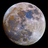 Full Moon. A saturation boosted image of the Moon. Natural lunar colors are very subdued but with digital enhancement we can see differences in surface Stock Photo