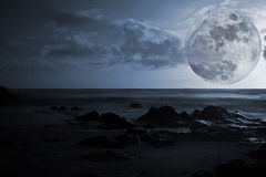 Full moon, sea and glowing rocks Royalty Free Stock Photo