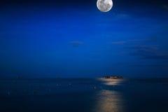 Full Moon in the sea weed farm, Sabah. Malaysia. Beautiful night Full Moon in the sea weed farm, Sabah. Malaysia royalty free stock image